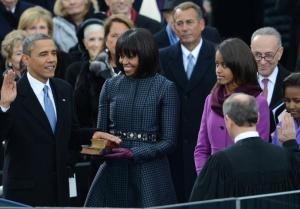 President Obama takes the oath of office as the First Lady holds Bibles used by MLK & Lincoln