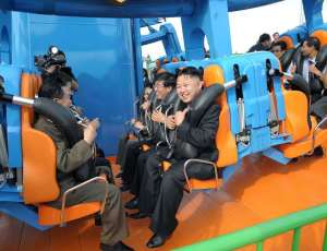 Kim Jong-Un on a roller coaster at, and I'm not joking, The Rungna People's Pleasure Ground.
