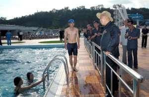 """No, no...I always go swimming with my dictator suit on. My body does look like that guy's though."""