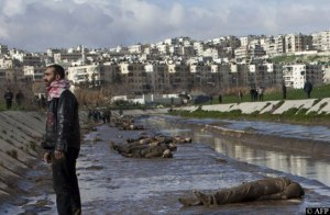 Bodies lie caked in mud on the banks of the Quwaiq River in Aleppo