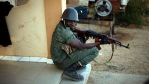 A Malian soldier resting during an assault to retake the city of Gao (Jerome Delay/Associated Press)