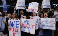 "Romney supporters hold up signs playing off of President Obama's ""you didn't build that"" statement at the 2012 Republican National Convention"